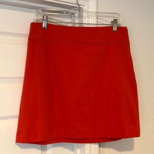 Orange side zipper mini skirt